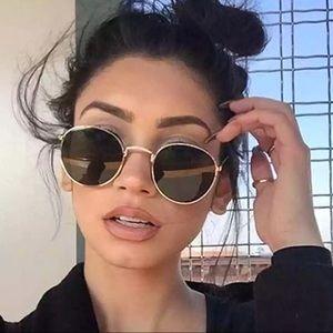 Round / oval Sunglasses dark green lens gold frame